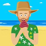 Young hipster man eating ice cream at the tropical beach wearing straw hat. Young hipster man eating an ice cream at the tropical beach wearing straw hat Stock Image