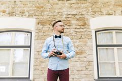 Young hipster man with film camera in city Stock Photo