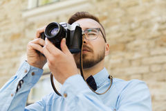 Young hipster man with film camera in city Stock Images