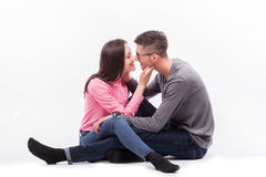 Young hipster man in glasses and woman sitting down and kiss Stock Images