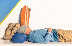 Young hipster man having a sleeping rest during travel Stock Photo