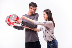 Young hipster Man hide a Gift on holiday his girlfriend. Stock Photo
