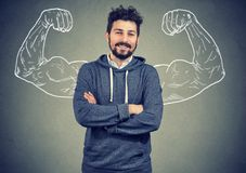 Overconfident man with strong hands stock images
