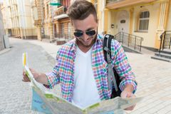 Young hipster man with map Royalty Free Stock Photography