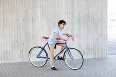 Young hipster man riding fixed gear bike Royalty Free Stock Photography