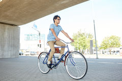 Young hipster man riding fixed gear bike Royalty Free Stock Images