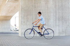 Young hipster man riding fixed gear bike Stock Photography