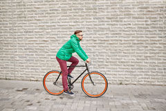 Young hipster man riding fixed gear bike Stock Photo