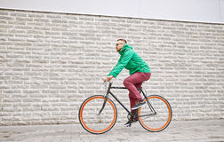 Young hipster man riding fixed gear bike Royalty Free Stock Photo