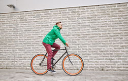 Young hipster man riding fixed gear bike Stock Images