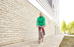 Young hipster man riding fixed gear bike Stock Image