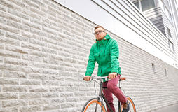 Young hipster man riding fixed gear bike Stock Photos