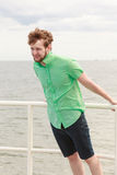 Young hipster man on sea pier Stock Images