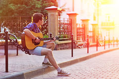 Young hipster man sitting during sunshine Royalty Free Stock Photo