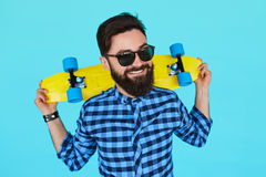 Young hipster man with a skateboard royalty free stock photos