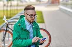 Young hipster man with smartphone and byke Stock Images