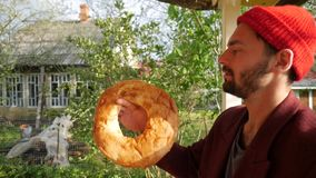 Young hipster man spinning pita bread. Summer outdoor vacation. HD slowmotion stock video