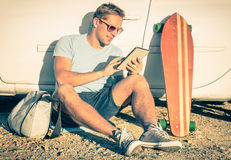 Young hipster man with tablet - Vintage travel concept Stock Images