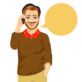 Young hipster man talking on the mobile phone with a speech bubble. On white background Stock Photo