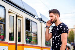 Young hipster man in a tram station Royalty Free Stock Photography