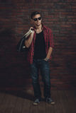 Young hipster man wearing sunglasses casual Royalty Free Stock Image