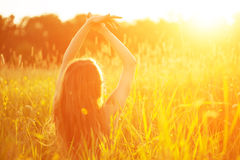 Young hipster model beauty woman, blowing Long Hair. Casual Girl. In the field in Sunset in spring or summer landscape background. Springtime. Summertime stock photography