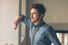 Young hipster portrait. Young hipster looking away and leaning on a wall royalty free stock images