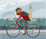 Young hipster riding bike. Young man hipster riding bike in London Royalty Free Stock Image