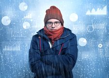 Young hipster shivering with graphs, reports and chart concept royalty free stock images