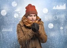 Young hipster shivering with graphs, reports and chart concept royalty free stock photography