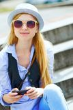 Young hipster sitting on bench in the city Stock Image