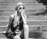 Young hipster sitting on stairs outdoors Stock Photos