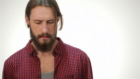 Young hipster style man posing in studio. Young hipster style caucasian man posing in studio. Life style concept: a young man with a beard. Hipster style. Over stock video footage