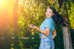 Young hipster stylish beautiful girl listening to music Stock Images