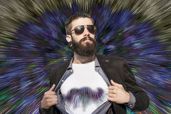 Young hipster superhero against colored background Stock Image