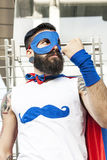 Young hipster superhero fights evil Royalty Free Stock Image
