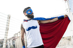 Young hipster superhero fights evil Royalty Free Stock Photo