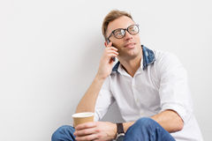 Young hipster talking on phone Stock Image