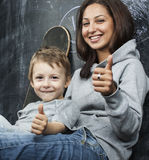 Young hipster teenage girl sitting with her brother in classroom multinational Royalty Free Stock Photo