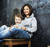 Young hipster teenage girl sitting with her brother in classroom Royalty Free Stock Photo