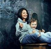 Young hipster teenage girl sitting with her brother in classroom Stock Images