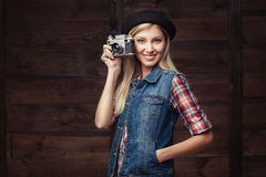 Young hipster woman in funky clothes isolated on white background Stock Images