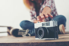 Young hipster woman hand reach out for catch retro camera. Woman hand reach out for catch retro camera Stock Images