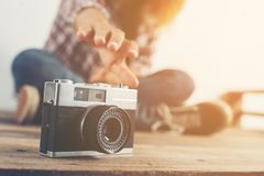 Young hipster woman hand reach out for catch retro camera. Young hipster woman hand reach out for catch retro camera background Royalty Free Stock Photography