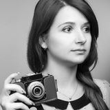 Young hipster woman make a photography with old camera Royalty Free Stock Photo