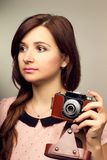 Young hipster woman make a photography with old camera Royalty Free Stock Images