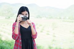 Young hipster woman photographer holding a vintage camera. stock image