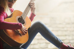 Young hipster woman plays guitar stock photos