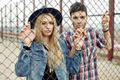 Young hipsters couple outdoor portrait.  royalty free stock photography