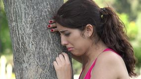 Young hispanic woman crying. A young hispanic adult female stock footage